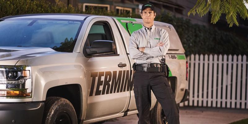 Technician standing in front of Terminix truck
