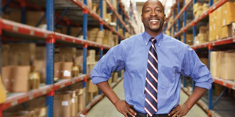 man wearing tie in front of boxes